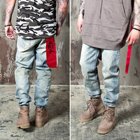 red strap loose fit denim jeans