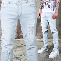 distressed pastel blue jeans