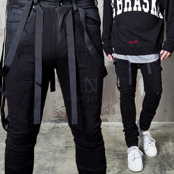 Distressed webbing tape coated black jeans