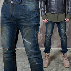 Distressed stain washed slim jeans