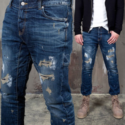 Distressed paint stain slim jeans