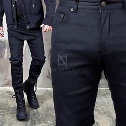 Heavily distressed slim jeans