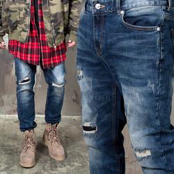 Distressed washed blue slim jeans