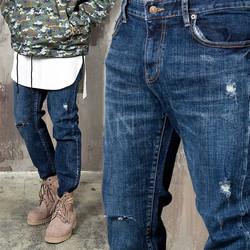 Distressed washed denim slim jeans