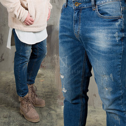 Distressed washed blue denim jeans