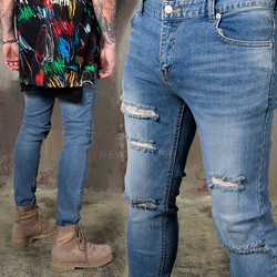 Multiple distressed scratch skinny jeans