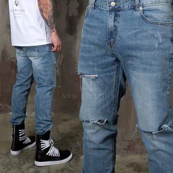 Triple distressed cut denim jeans