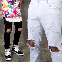 Distressed ripped knee slim jeans