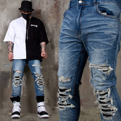 Pintuck leather layered distressed slim jeans
