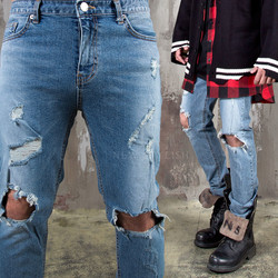 Ripped knee distressed blue slim jeans