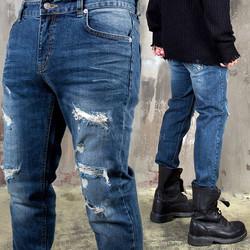 Distressed blue denim jeans