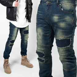 Distressed and ripped pintuck slim jeans