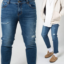 Distressed blue slim jeans