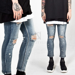 Distressed washed paint stain slim jeans