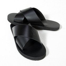 Crossed black leather slipper