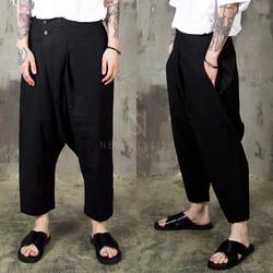 Diagonal wrap type baggy pants