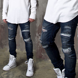 Extra distressed deep blue slim jeans