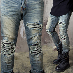 Extra distressed pintuck slim jeans
