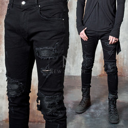Distressed and ripped pintuck black slim jeans