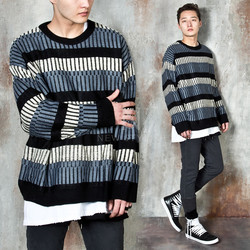 Multiple contrast striped round knit sweater