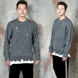 Distressed damaged knit sweater