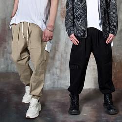 Avant-garde banded harem pants