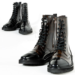 Straight-tip brogue commando sole leather boots