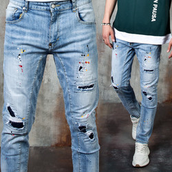 Distressed paint accent washed blue slim jeans