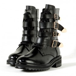 Gold buckle belted black boots