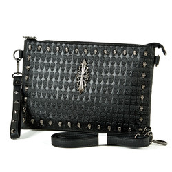 Heraldry symbol and skull studded clutch bag