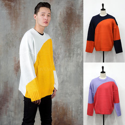 Curved contrast knit sweater