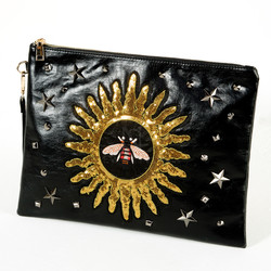 Gold spangle clutch bag