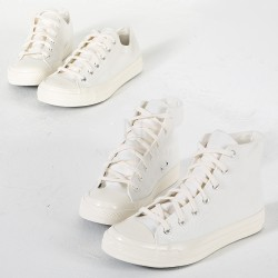White lace-up canvas sneakers