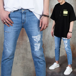 Distressed and ripped blue jeans