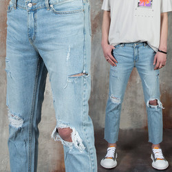 Distressed and ripped light blue jeans