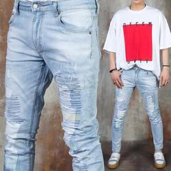 Distressed zigzag stitch light blue slim jeans