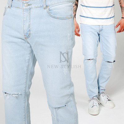 Distressed ice blue jeans