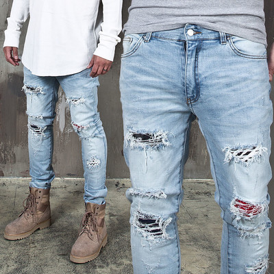 Artistic pattern layered distressed blue jeans