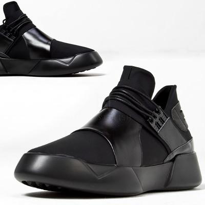 Futuristic black leather contrast sneakers