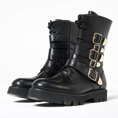 Multiple gold belted black boots