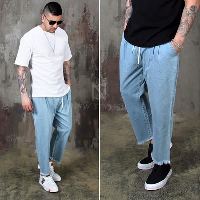 Distressed crop hem banded baggy denim jeans