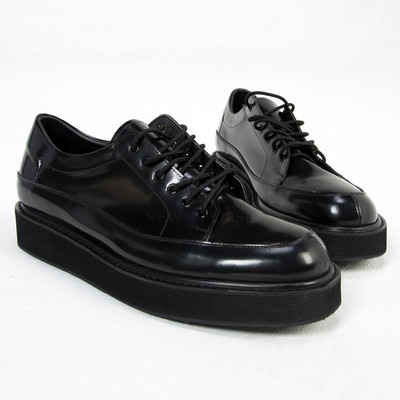 Big sole black lace up shoes