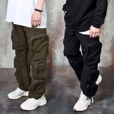 Multiple zippered 3D pocket banded pants