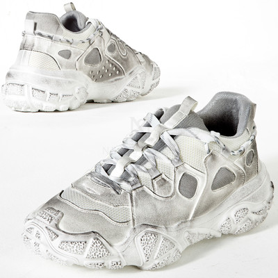 Stained white ugly sneakers