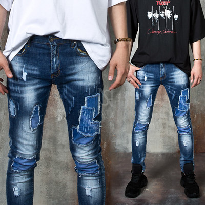 Distressed patchwork accent slim jeans