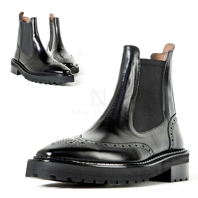 Wing-tip chelsea boots