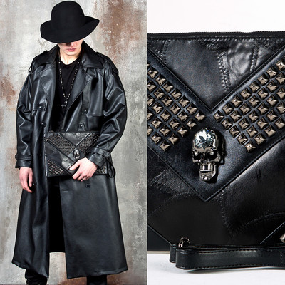 Crystal metal skull studded leather clutch bag