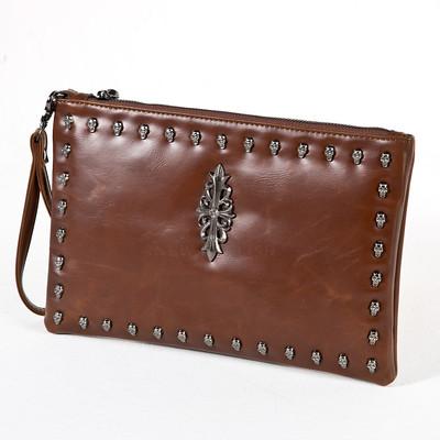 Heraldry symbol and skull studded brown clutch bag
