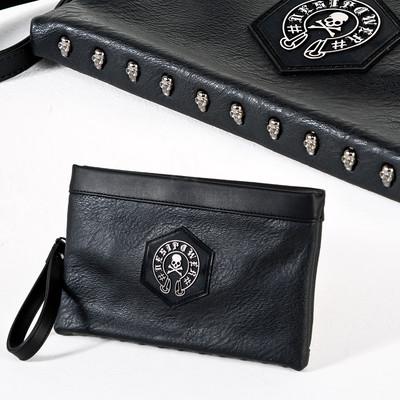 Skull symbol leather clutch bag