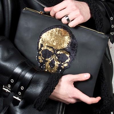 Gold spangle skull clutch bag
